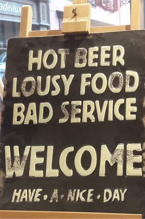 Hot beer, lousy food, bad service, ... welcome, have a nice day.